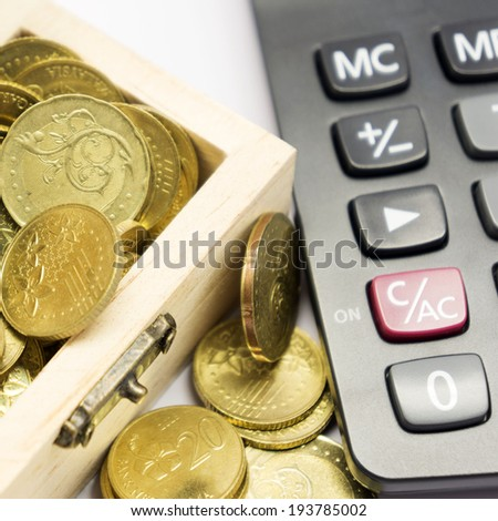 calculators with coins - stock photo