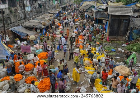 CALCUTTA - APRIL 13: busy activities at the Howrah flower market on April 13, 2014 in Calcutta, India. Locals come here to buy flowers for worshiping their gods.  - stock photo