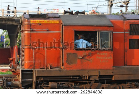 CALCUTTA - MARCH 27: locomotive of an Indian Railways train on March 27, 2014 in Calcutta, India. Indian Railways is a state-owned enterprise and carries 8.4 billion passengers annually.  - stock photo