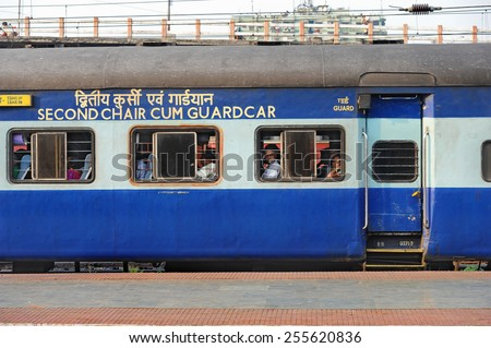 CALCUTTA - MARCH 27: passengers on board a Indian Railways train on March 27, 2014 in Calcutta, India. Indian Railways carried 8.4 billion passengers annually or more than 23 million passengers daily. - stock photo