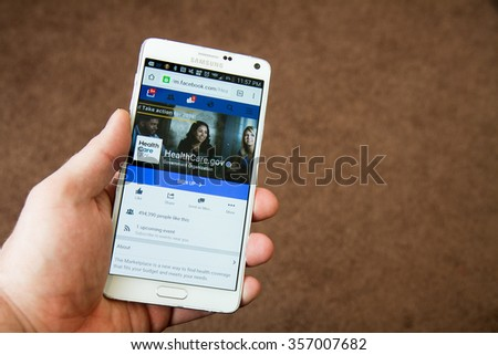 CALDWELL, IDAHO/USA - NOVEMBER 18,2015: Person looks at the healthcare.gov Facebook page on their mobile device in Caldwell, Idaho - stock photo