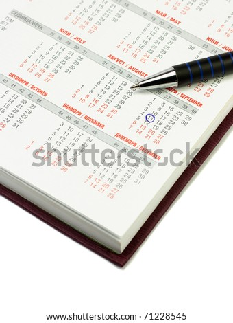 Calendar and pen over white background. September 11 checked - stock photo