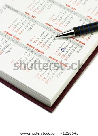 Calendar and pen over white background. September 11 checked - stock photo