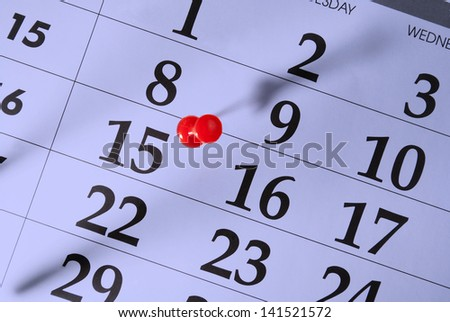 Calendar and pushpin on the fifteenth