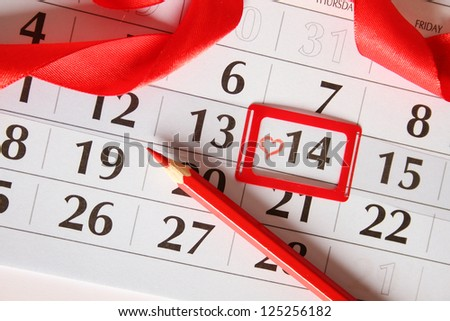 Calendar, by February 14. Painted red heart. Background - stock photo