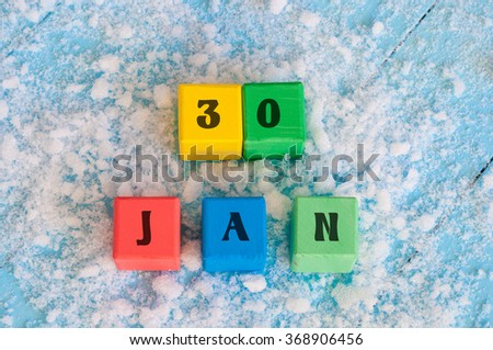 Calendar date on color wooden cubes with marked Date of 30 Of January - stock photo