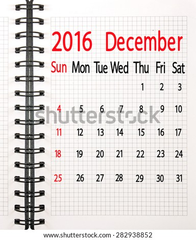 calendar for the month of December on the notebook sheet - stock photo