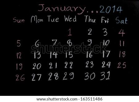 "calendar ""January 2014"" on a blackboard  - stock photo"