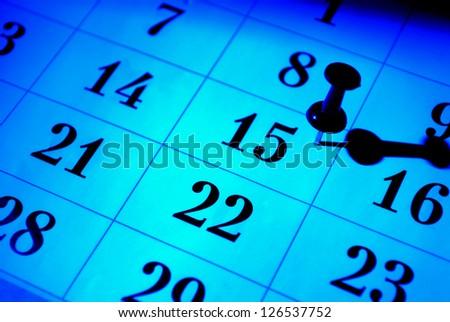 Calendar lit with creative blue, close-up shot - stock photo