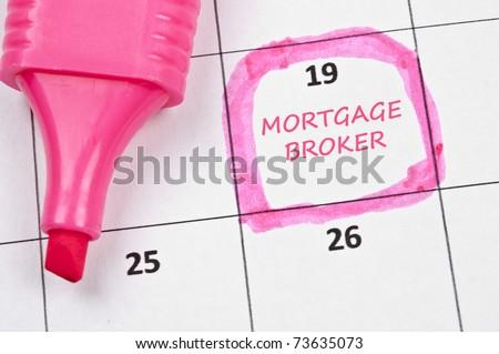 Calendar mark with Mortgage broker - stock photo