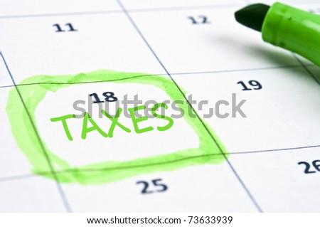 Calendar mark  with Taxes - stock photo