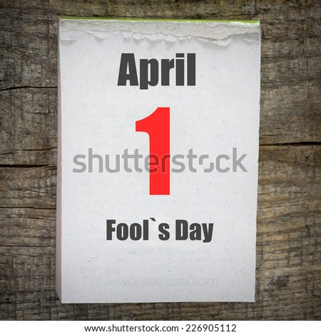 Calendar on old wooden wall. 1 April, Fool`s Day. - stock photo
