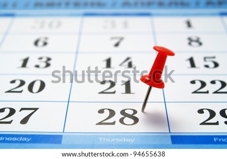 calendar page and a red pushpin, mark the date - stock photo
