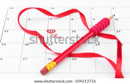 Calendar page with hearts, pencil and ribbon on St.Valentines Day - stock photo