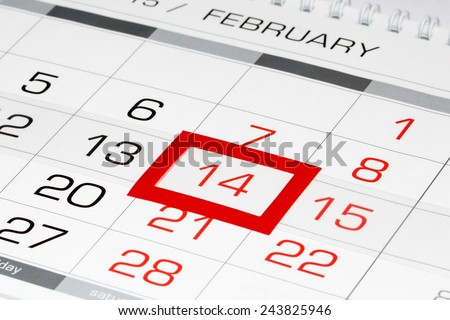 Calendar page with marked date of Saint Valentine's Day - stock photo