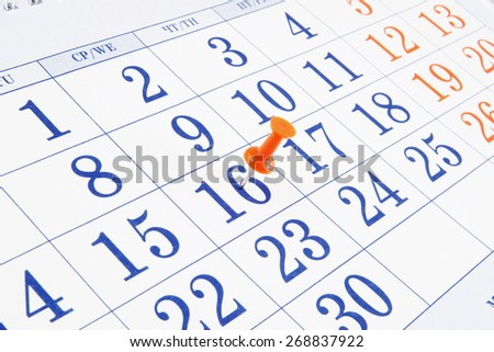 Calendar page with push pin close up - stock photo