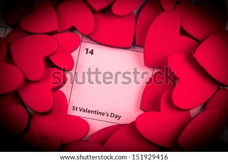 Calendar page with red hearts highlight on February 14 - stock photo