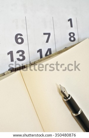 Calendar, pen and notebook