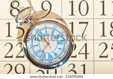 calendar pocket watch old grandfather - stock photo