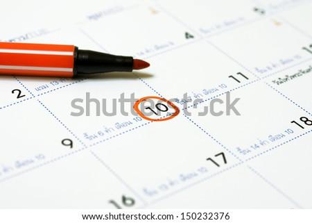 Calendar with circle marking at 10 - stock photo