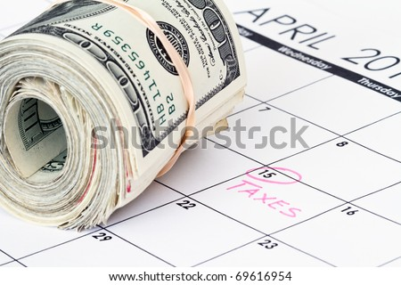 calendar with tax due date and refund money - stock photo