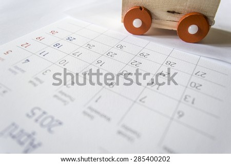 Calendar with toy - stock photo