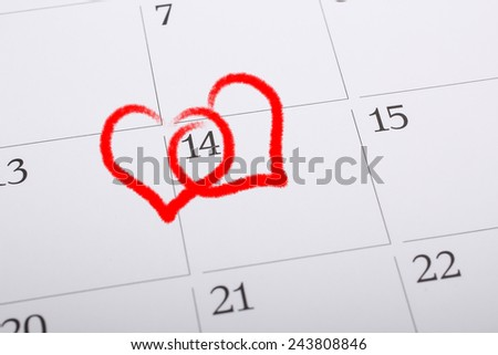 calender page with a detail of the valentine day - stock photo