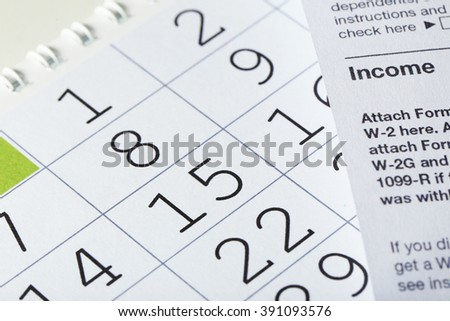 Calender with dates and tax form, close up