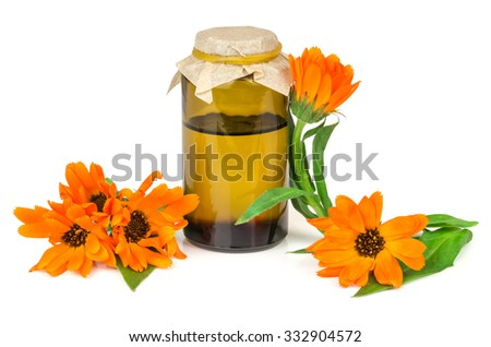 Calendula  Marigold flowers with oil isolated on a white background - stock photo