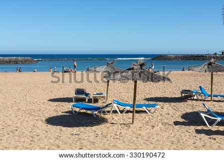 CALETA DE FUSTE, SPAIN - SPETEMBER 6, 2015: Sun lounger on the beach of Caleta de Fuste, Canary Island Fuerteventura, Spain - stock photo