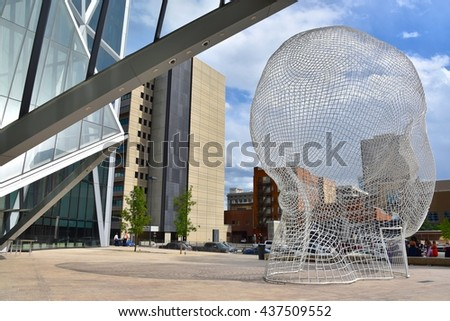 CALGARY, AB- MAY 29: The Bow Building and the Wonderland Sculpture on May 29 2016 in Calgary, AB. Calgary has prominent buildings in a variety of styles by many famous architects.