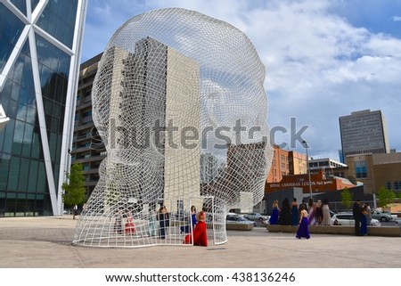 CALGARY, AB- MAY 29: The Bow Building and the Wonderland Sculpture on May 29 2016 in Calgary, AB. Calgary has prominent buildings in a variety of styles by many famous architects. - stock photo