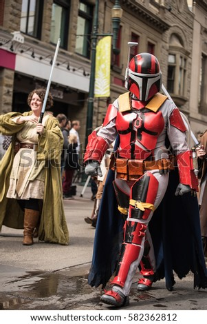 Calgary, Alberta, Canada, April 29 2016: Comic and Entertainment Expo Parade Red Mandalorian Warrior cosplay