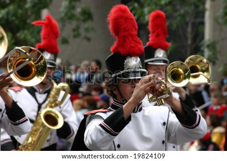 CALGARY ALBERTA JULY 2004 - Horn players,  marching band in white and black uniforms,Calgary Stampede ParadeAlberta - stock photo