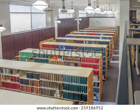 CALGARY, ALBERTA - MAR 7: The Law Library of the Faculty of Law at the University of Calgary on March 7, 2015 in Calgary, Alberta Canada.  This modern Law Library houses cases and statues of Canada.  - stock photo