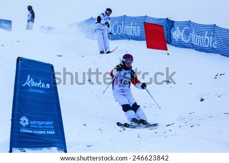CALGARY CANADA JAN 2 2015. FIS Freestyle Ski World Cup, Winsport, Calgary Ms. Mikaela Matthews from USA  and an other Unidentified contender   at the Mogul Free Style World Cup on practice day.  - stock photo
