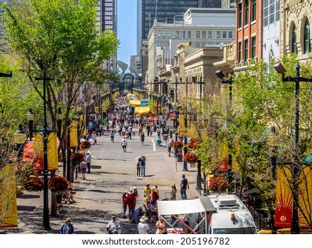 CALGARY, CANADA - JULY 13: Busy Stephen Avenue in Calgary during Stampede on July 13, 2014 in Calgary, Alberta Canada. This shopping and pedestrian plaza is the heart of downtown Calgary. - stock photo
