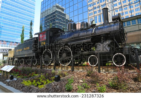 CALGARY, CANADA - JULY 29: Canadian Pacific Railway Locomotive 29 on July 29, 2014 in Calgary. It was the last steam locomotive to close out the railway's steam era in 1960. - stock photo