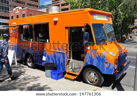 CALGARY, CANADA - JULY 27: Food Fighter food truck on July 27, 2012 in Calgary, Alberta. The mayor of Calgary has pushed through a new law finally allowing for the popular street meat vendors.
