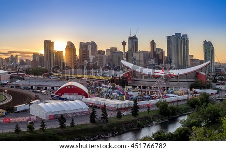 CALGARY, CANADA - JULY 8: Panoramic view of the  the Calgary Stampede at sunset on July 8, 2016 in Calgary, Alberta. The Calgary Stampede is often called the greatest outdoor show on Earth. - stock photo