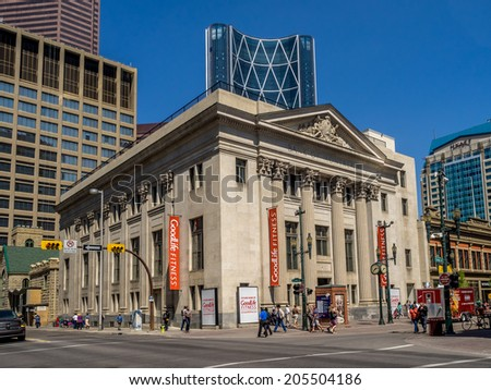 CALGARY, CANADA - JULY 13: Pedestrians walking past theGoodlife Fitness store on July 13, 2014 in Calgary, Alberta. The heritage building is located on Stephen Avenue pedestrian mall in Calgary.
