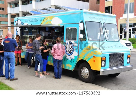 CALGARY, CANADA - JULY 27: Vasili's food truck on July 27, 2012  in Calgary, Alberta. The popular mayor of Calgary has pushed through a new law finally allowing for the popular street meat vendors.
