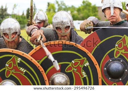"""CALGARY CANADA JUN 13 2015:  The Military Museum organized """"Summer Skirmish"""" event where an unidentified soldier is seen  in a historical Reenactment Battle. Viking solder in action. - stock photo"""