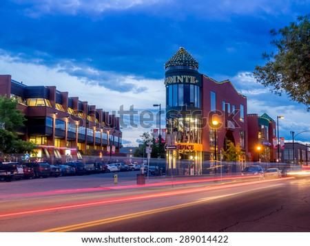 CALGARY, CANADA - JUNE 12: Buildings in Calgary's Kensington area on June 12, 2015. It is known for trendy restaurants, nightlife, galleries and upscale shops, all popular with locals and tourists. - stock photo