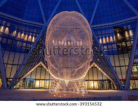 CALGARY, CANADA - MAR 13: Wonderland sculpture by Jaume Plensa in the front of the Bow Tower on March 13, 2016 in Calgary, Alberta, Canada. Jaume Plensa is a Catalan Spanish artist and sculptor. - stock photo