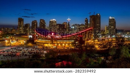 CALGARY, CANADA - MAY 23: Sunset over Calgary's skyline with the Scotiabank Saddledome in the foreground May 23, 2015. The dome is home to the Calgary Flames NHL club and Lacrosse's Roughnecks.