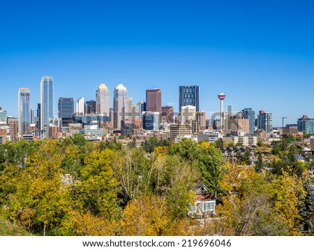 Calgary skyline from the south looking north. Fall foliage is in the foreground.  - stock photo