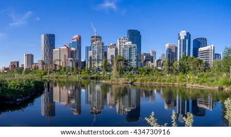 Calgary skyline reflected in a reconstructed urban wetland along the Bow River.