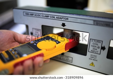 Calibration clamp meter with clamp coil adaptor - stock photo