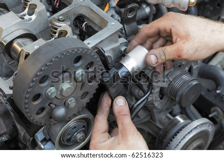 Calibration of belt with tool on modern engine - stock photo
